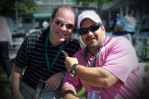 a friend and randy cohen at the masters
